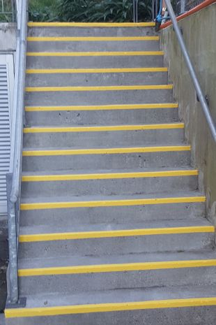 Safety yellow non-slip Nose Cones on concrete steps