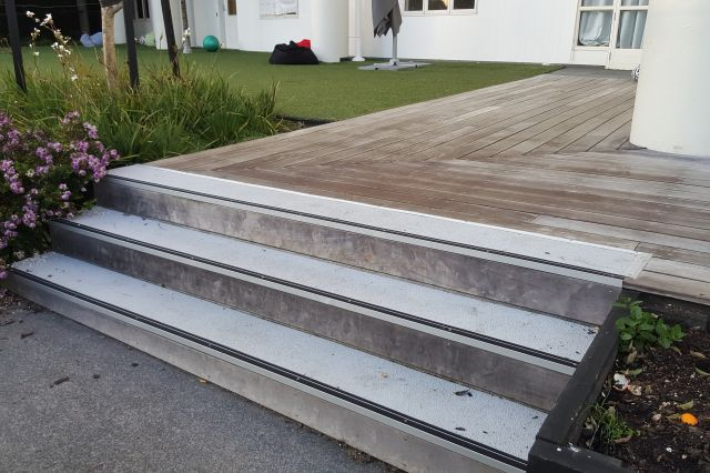 Steps renovated with Anti-Slip Nose Cones and restained